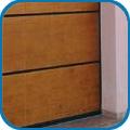 Alumíniumkeretes szekcionált garázskapuk fa borítással